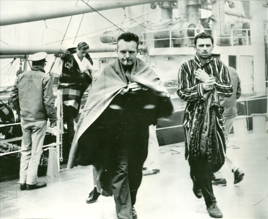 Cedarville Survivors: Ralph Przybyla, Stanley Mulka and Jerome Kierzek getting off the United States Coast Guard cutter Mackinaw (WAGB -83) after their ship, SS Cedarville collided with the Norwegian vessel Topdalsfjord in May 1965.