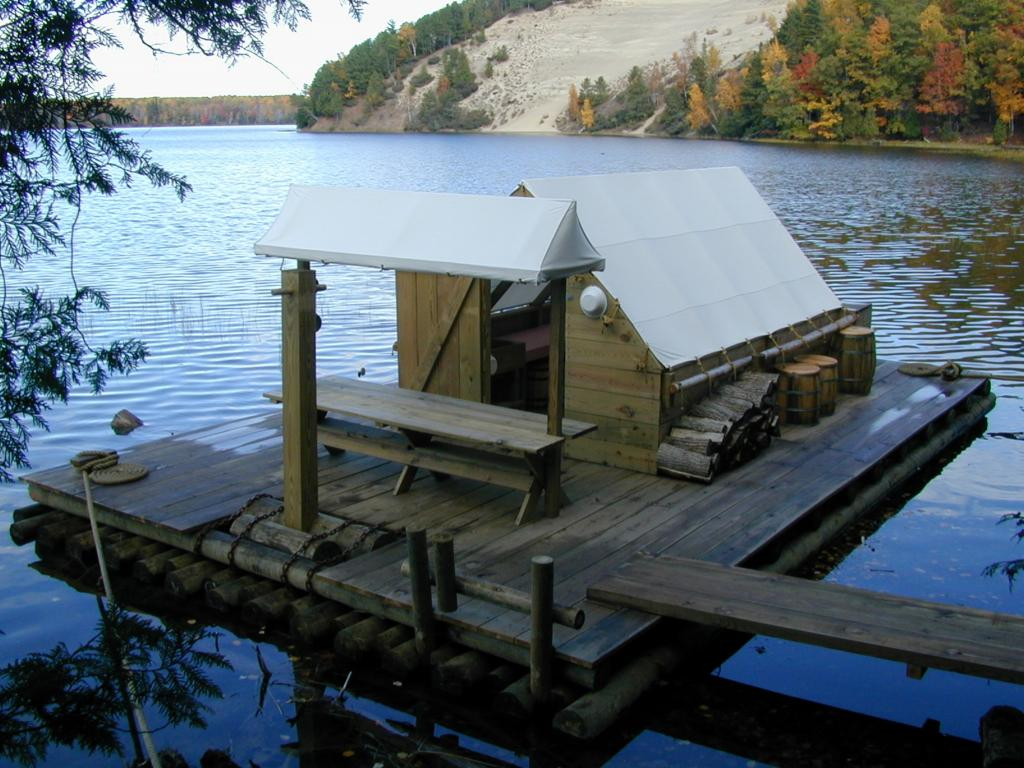 Floating cook shack sits on the river's edge.